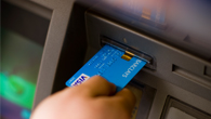 Person completing ATM transaction